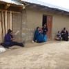 Women working with wool outside of the entrance to the Sarcofagos de Karajia, Peru