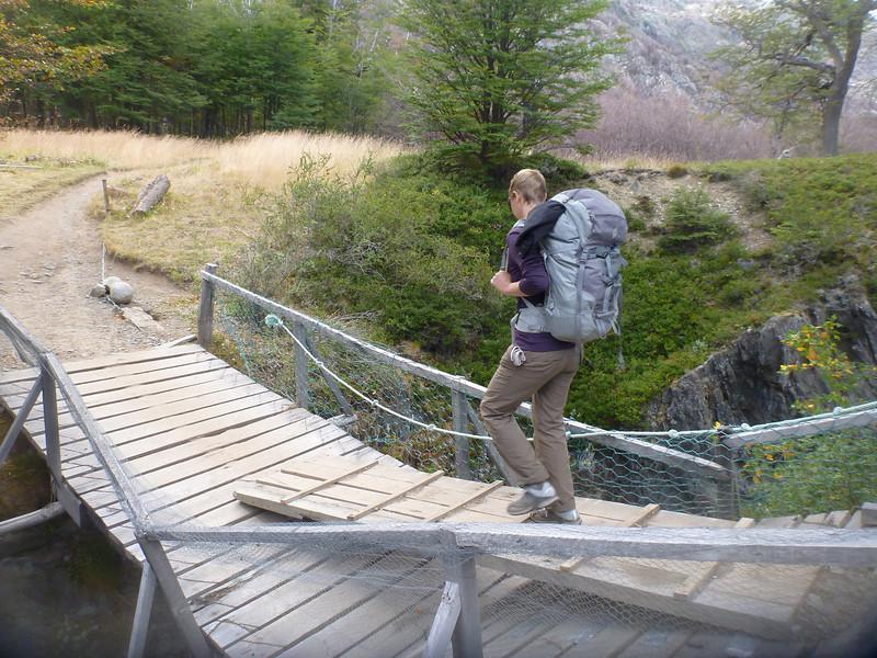 Jill crossing a bridge on a bridge.  Torres del Paine