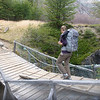 Jill crossing a bridge on a bridge.  Torres del Paine