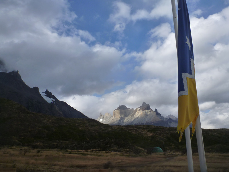 Magallanic flag with Cerro Paine Grande lit up in background, Torres del Paine