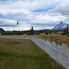 Helicopter taking off from CONAF administration building, Torres del Paine