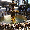 fountain of love with padlocks surrounding it.  There are two tango dancers in the background that almost got Mike hit by a car as he waited for a chance to snap a picture (their fault, definitely).