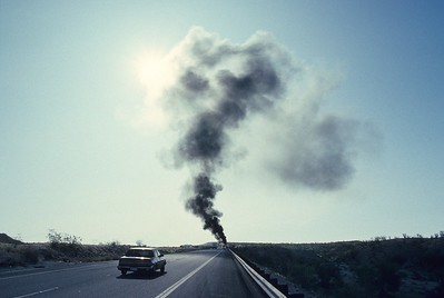 On the road to Sedona in Arizona. A camper is burning on the shoulder of the highway.