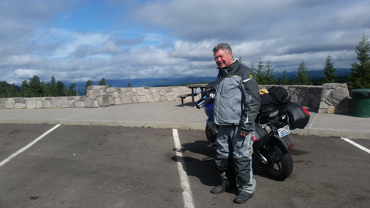 With fewer clouds, you would be able to see Mt. St. Helens behind me.  In the Washington National Forest SE of St. Helens.