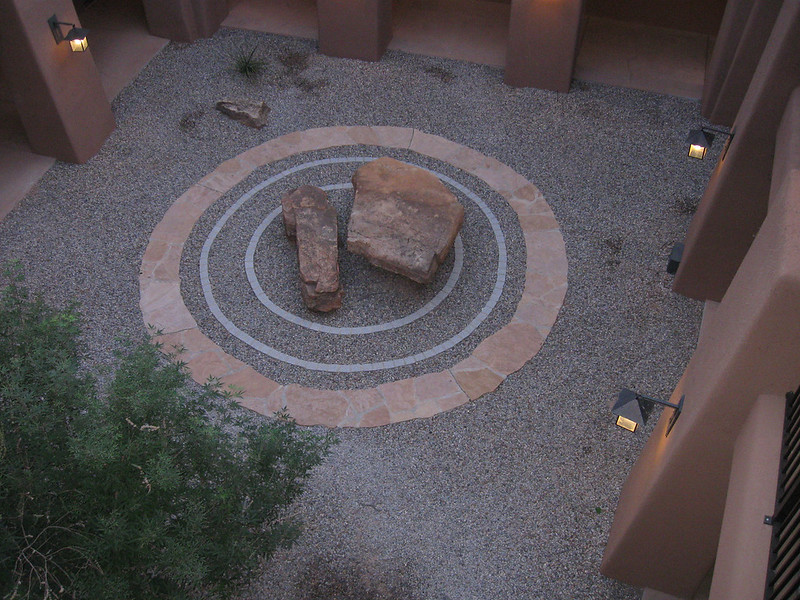 A stairwell at the Hyatt with a zen sand and rock design.