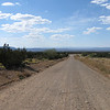 My dirt road connector from the Turquoise Trail that heads West to the interstate for a quick run South to the Hyatt. This surface was fine, but there were a couple of sandy patches and I started working towards my Ewan McGregor merit badge by dropping the bike in the sand. DOH! Fortunately, it was within my powers to right it.....and no damage was done to bike or driver.