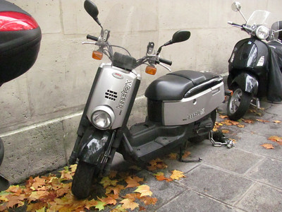Funky scooter.  I know we have Yamahas here that are like these...