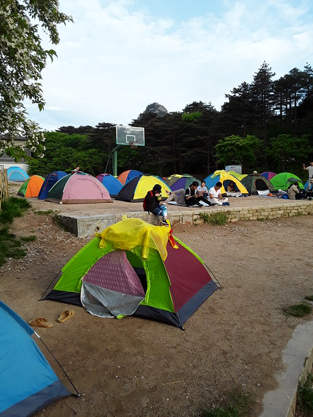 Backpacker tent city outside of the hotel buildings