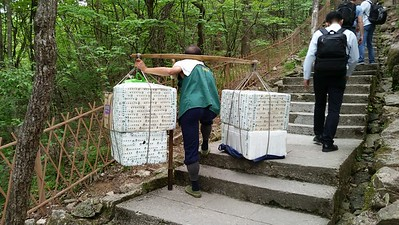 This guy makes 60 RMB for each 50kg load.  He was carrying 100 kg.  This is how all supplies are delivered to the summit hotels and concession stands.