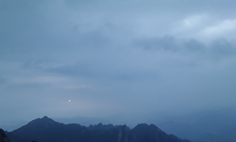 There it is - a dot of pink in a gray sky.  This is why we got up at 04:15 and hiked back to the summit?