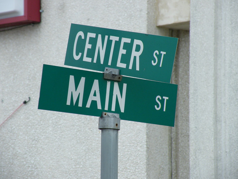 "The junction of Center Street and Main Street. Usually called ""The corner of Senner & Main"""