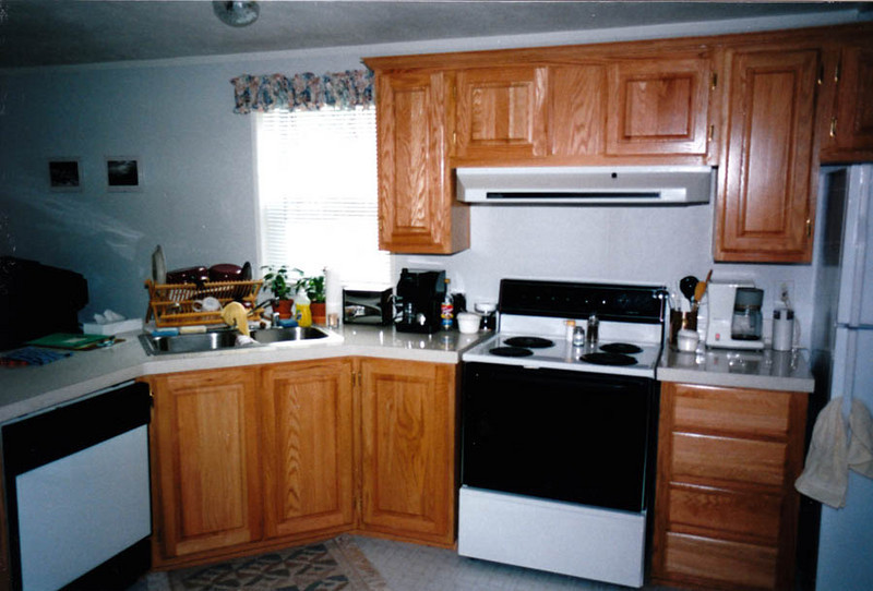 THE KITCHEN<br /> This wasn't too bad, though. Nice kitchen. That's my wooden dish drainer behind the sink. I still have that thing.