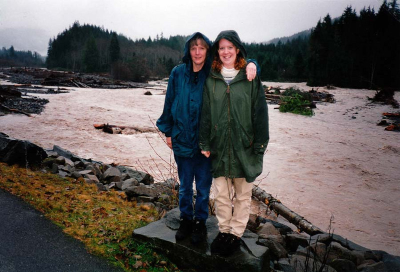 PAULA AND LISA<br /> Sunrise Campground, Mt Rainier National Park<br /> <br /> This was taken during a flood period, when we were evacuated to town. We probably weren't supposed to be here right now, but what the heck? How often do you get to see a flood? That's the Nisqually River roaring by, taking trees with it.