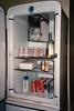 BACHELOR FRIDGE<br /> Yep, this is a bachelor's fridge, all right. Well, in my defense, all my food needs were taken care of by the company -- we had an employee dining room that served us three meals a day -- so storing food stuffs wasn't a high priority. Check out that doorless freezer. I think there probably should've been a door, but it worked okay as it was.