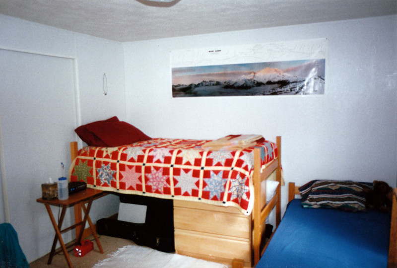 MY BEDROOM<br /> I still haven't figured out the concept of the raised bed, other than it made space for the small dresser underneath. It was a challenge to sleep in. The other bed was supposed to be for my roommate, but I managed to run him off. I don't do roommates.