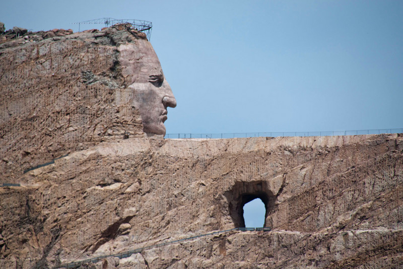 The head is 87 feet tall vs. 60 feet for the US presidents at Mt. Rushmore.  A bus drives vistors through the hole to the other side.  You can climb up a trail to the fenced areas.  I saw some people there but they were gone before I could get a picture.  We didn't leave the visitors' center.