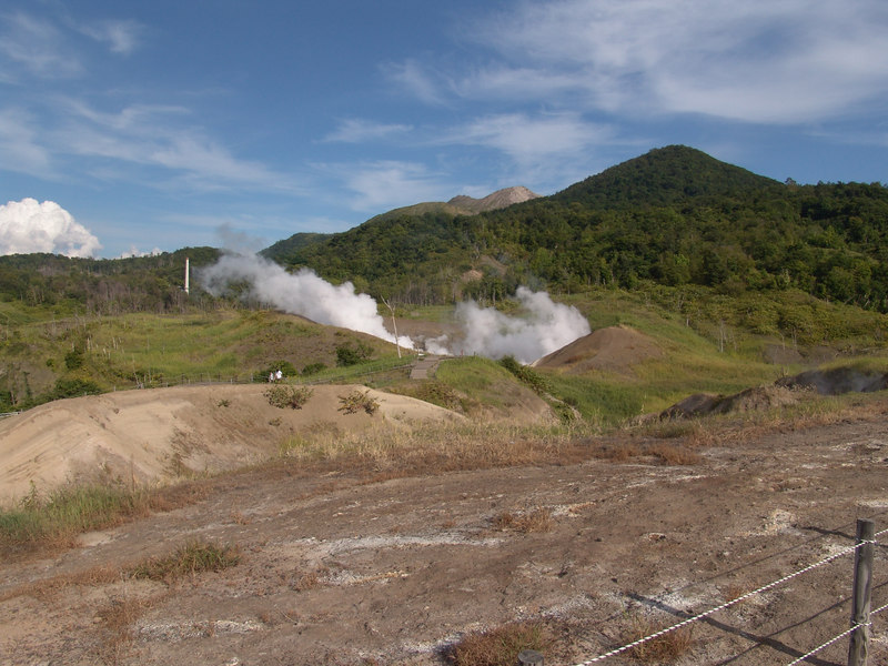 This is looking towards the main vent from a higher vantage point.  Note the people in view for a size reference.  In the background is Mt. Uzu, the rather bald looking peak is seen.