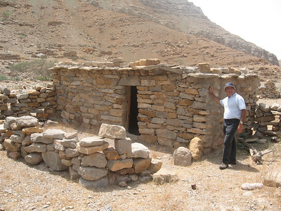 "Malcolm outside one of the mountain houses.  Why do the words ""do-er up-er"" spring to mind...."