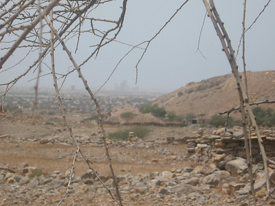 Ancient and modern: Stone house on the right and the modern towers of RAK in the distance.