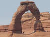 Some hikers under Delicate Arch who braved the intense heat.