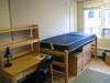 Other side of the dorm room. Two beds, desks, chairs, closets, etc.