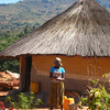 Mozambique - Manica - Chazuka - Flora's daughter and her home.