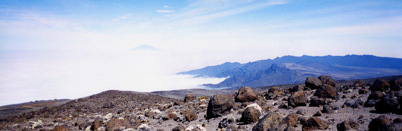 Barren landscape. Mt Meru (Africa's 2nd highest) faintly in background.