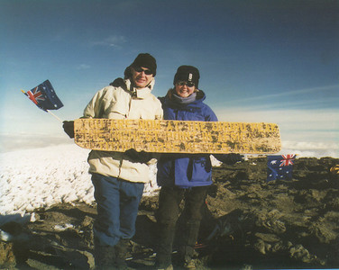 "Holding the traditional ""summit board"""
