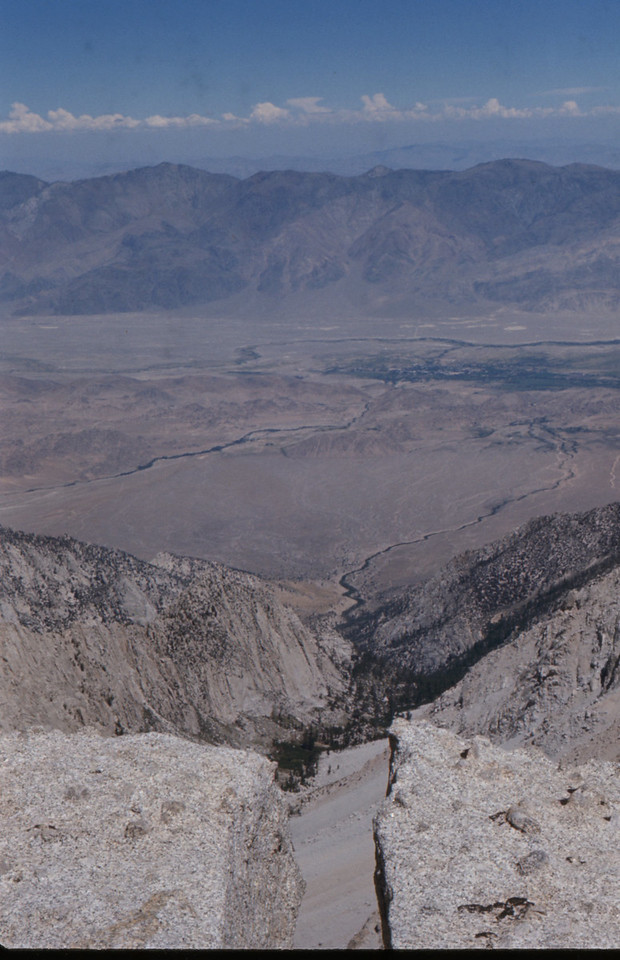 Looking down the crack between the rocks at the summit the canyon drops 7000 feet to the valley floor