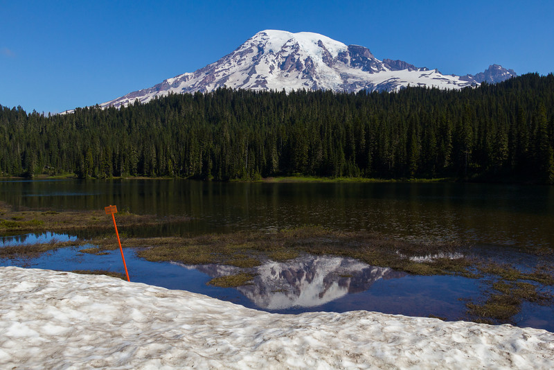 This snow bank projected over Reflection Lake at its west end.
