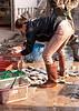 Fishmonger At Muang Sing Market, Lao People's Democratic Republic