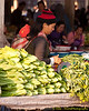 Mother and Baby Tending Vegetable Stall At Muang Sing Market, LPDR