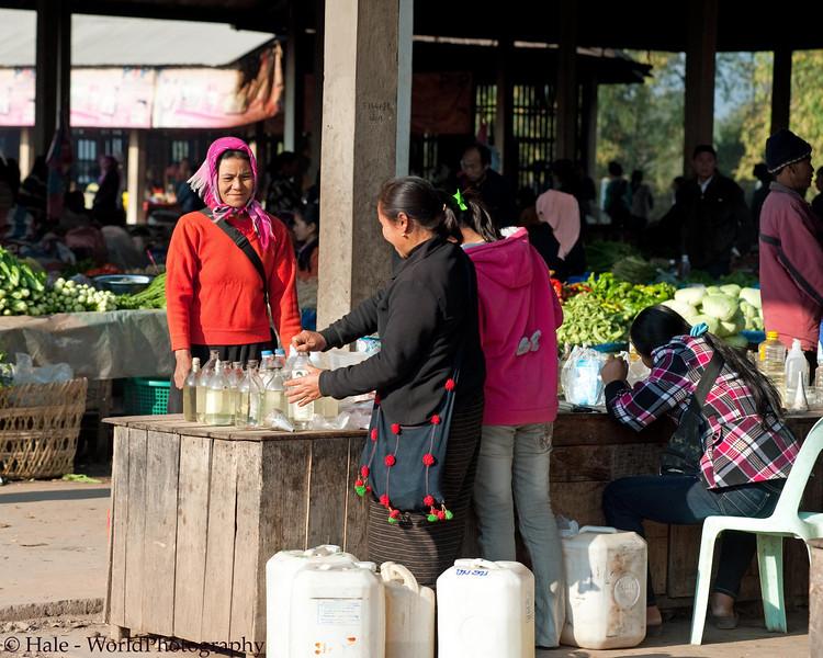 Purchasing Some Cooking OilAt Muang Sing Market, Laos