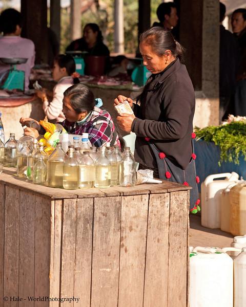 Cooking Oil Vendors At Muang Sing Market, Luang Namtha Province, Laos