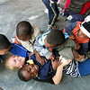 Another volunteer loving and being loved by the kids