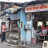 slum barbershop and chicken sales