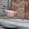 broken pot on a broken window sill in  a broken city