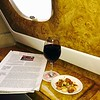 Gearing up for take off with my favorite flight companions: A good newspaper, French Malbec, and warm, roasted nuts. Flight duration: 18 hours, 55 minutes.