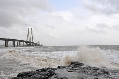Arabian sea water lashing at the under construction Bandra to Worli Sea Link in Mumbai during the monsoon rains. Mumbai, MH, India