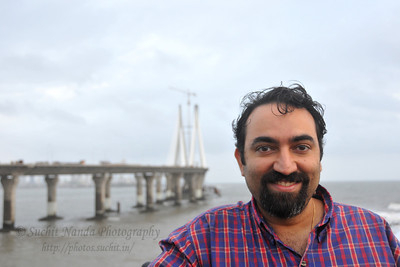Suchit in strong winds at Bandra to Worli Sea Link in Mumbai during the monsoon rains. Mumbai, MH, India