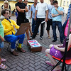 An artist on Old Arbat Street paints a portrait of a young girl.