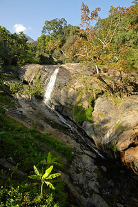 Waterfalls seen enroute to Munnar from Coimbatore.  Munnar is a town located in Idukki District of  Kerala (located in the southern Western Ghats). The area is surrounded by vast jungles and is 1600 m (5400 ft) above sea level. There are three rivers - Madupetti, Nallathanni and Periavaru which flow through this town.