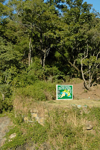 "Kerala Forest Department's sign ""Chinnar Wildlife Sanctuary"". Munnar is a town located in Idukki District of  Kerala (located in the southern Western Ghats). The area is surrounded by vast jungles and is 1600 m (5400 ft) above sea level. There are three rivers - Madupetti, Nallathanni and Periavaru which flow through this town."