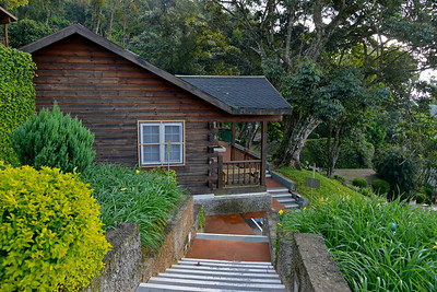 """Cottages at Club Mahindra Munnar, Lakeview.  Munnar ( ??????? ) is situated on the Kannan Devan Hills ( KDH ) Village in Devikulam taluk. Munnar is a famous hill station on the Western Ghats of India. A range of mountains situated in the Idukki district of the Indian state of Kerala. The name Munnar means """"three rivers"""", referring to the town's strategic location at the confluence of the Madhurapuzha, Nallathanni and Kundaly rivers."""