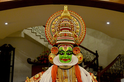 "Kathakali in Kerala, India.   Munnar ( മുന്നാർ ) is situated on the Kannan Devan Hills ( KDH ) Village in Devikulam taluk. Munnar is a famous hill station on the Western Ghats of India. A range of mountains situated in the Idukki district of the Indian state of Kerala. The name Munnar means ""three rivers"", referring to the town's strategic location at the confluence of the Madhurapuzha, Nallathanni and Kundaly rivers."