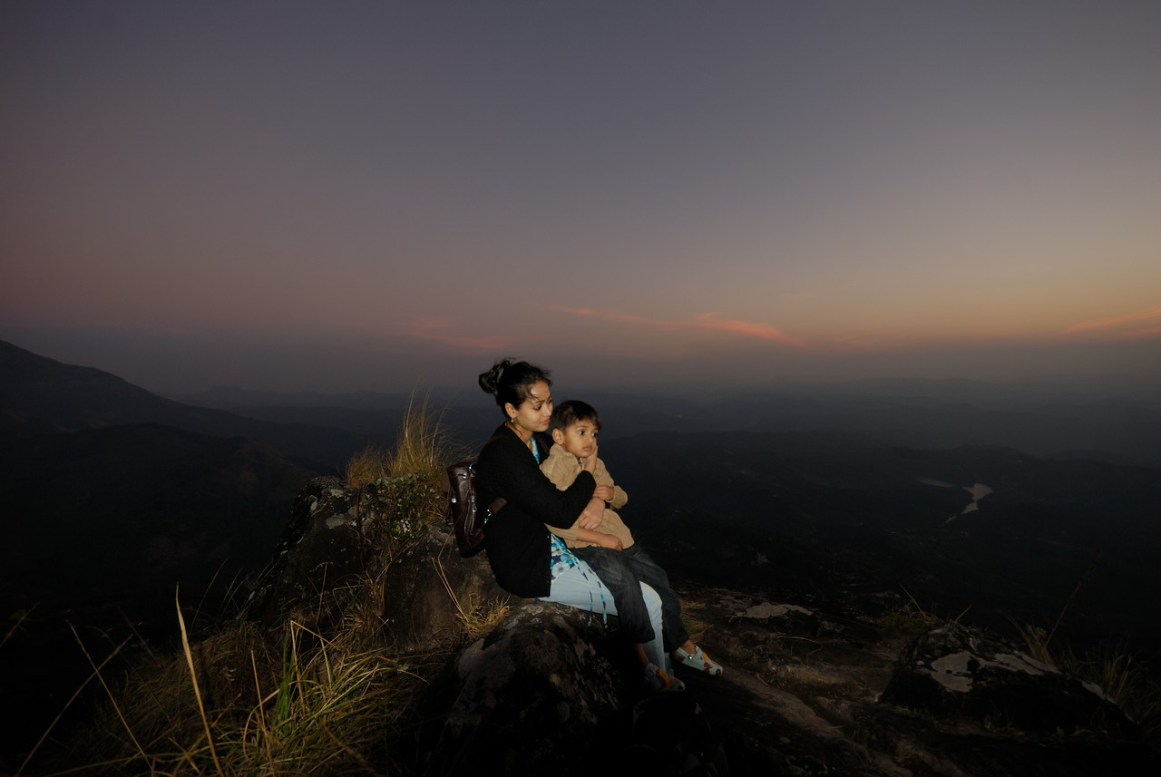 Preeti and Arnav sitting on the cliff with straight fall just 2 feet away from them