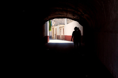 John & Neil enter a dark passageway, Caravaca de la Cruz