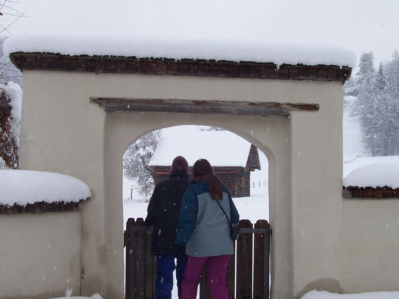 Becky and Jonas walk through the gate.