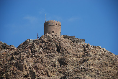 Castle tower on the headland overlooking Muscat Harbour.