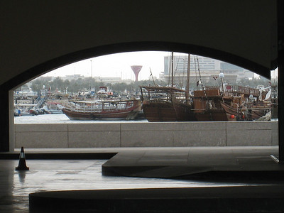 Dhows seen through the car park.  An island was formed to be the site of the museum.